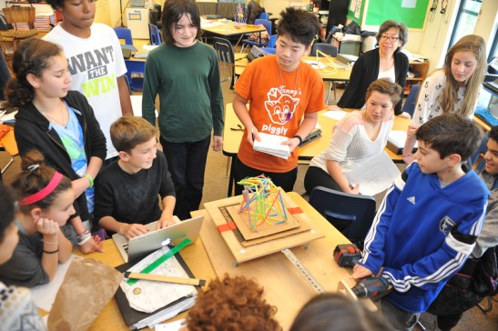 """Science students shake testing structures in Middle School Dec 3, 2014."""